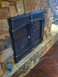 Iron fireplace grill
